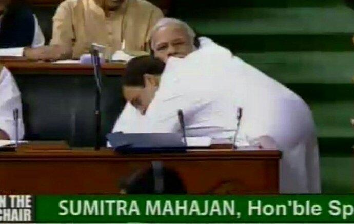 Rahul Gandhi hugging prime minister narendra modi in the parliament