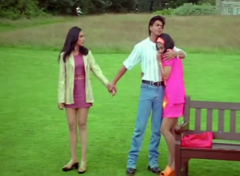 shahrukh khan hugging kajol while holding one hand of Rani Mukerji in the movie Kuch Kuch Hota Hai