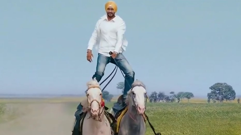 Ajay Devgan riding on two horses in the movie son of sardaar