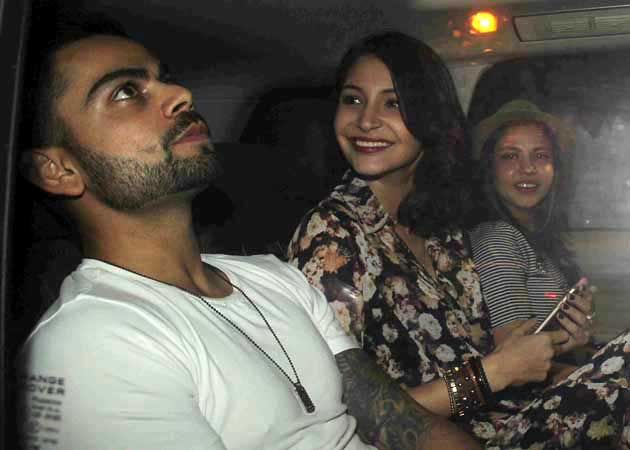 Anushka Sharma saying something to Kohli in a car after coming out of a dinner party