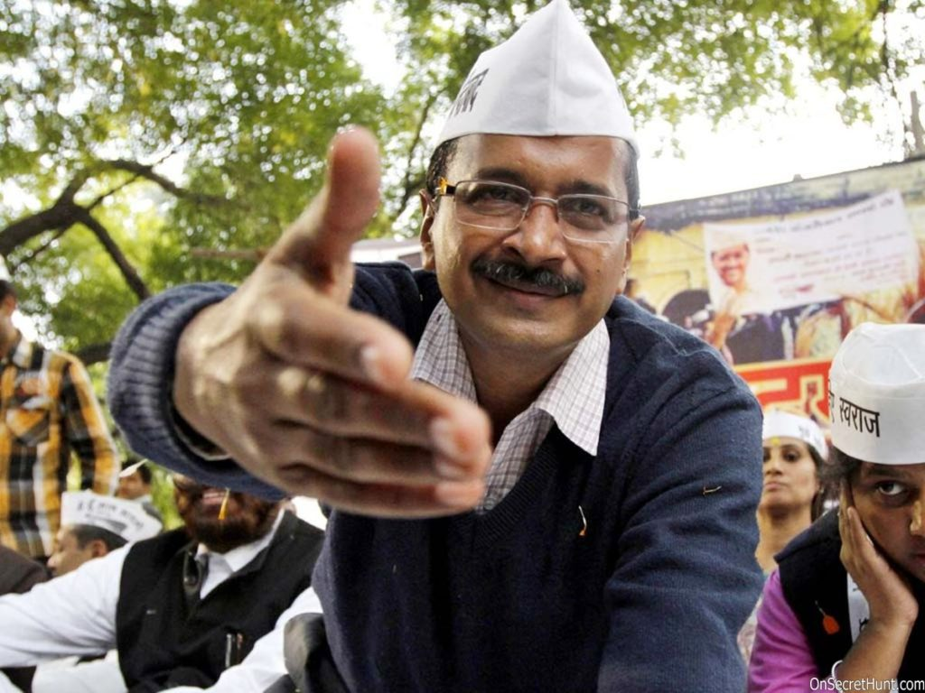 Arvind Kejriwal with party leaders during Aam Aadmi Party's victory rally offering his hand to handshake
