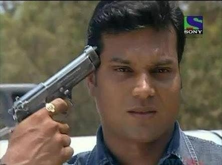 CID inspector Daya pointing a gun on himself