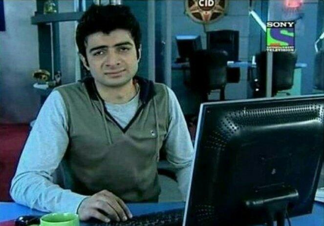 CID Inspector Vivek sitting with a computer looking sad meme