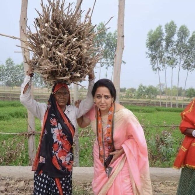Hema Malini helping a villager woman funny photo and meme template