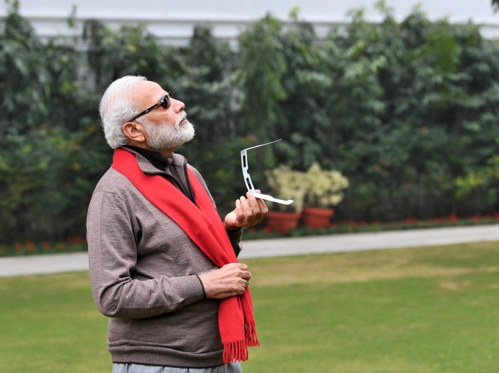 Narendra Modi watching the solar eclipse with black shades meme
