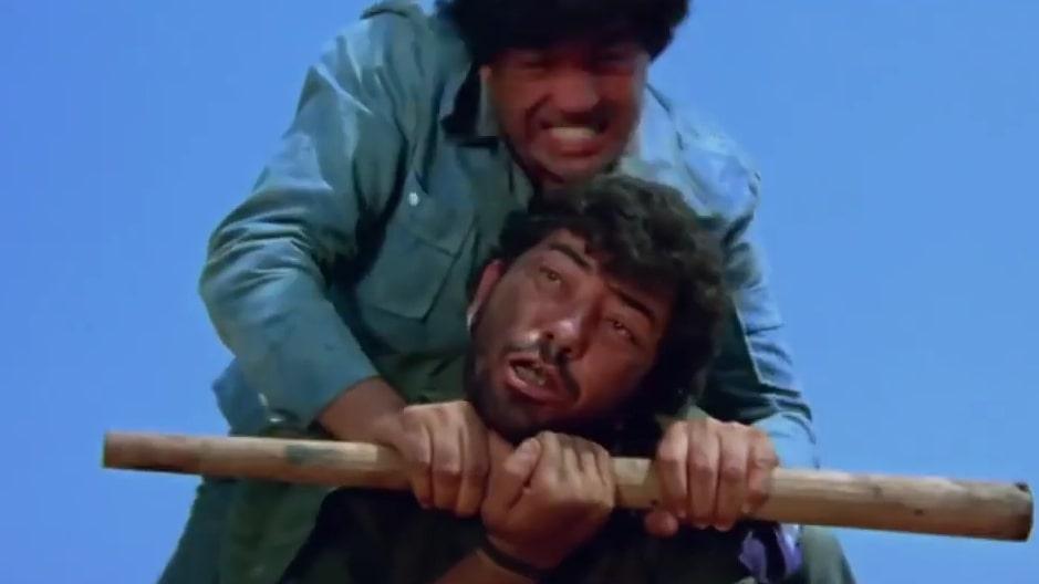 Veeru beating Gabbar Singh in sholay movie