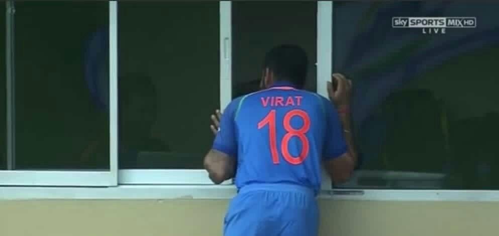 Virat Kohli peeping through the dressing room meme