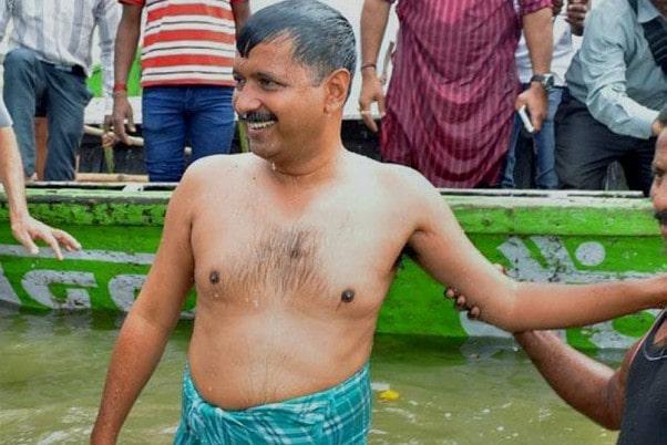 arvind kejriwal taking a bath in river ganga