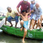 arvind kejriwal taking a dip in river ganga varanasi