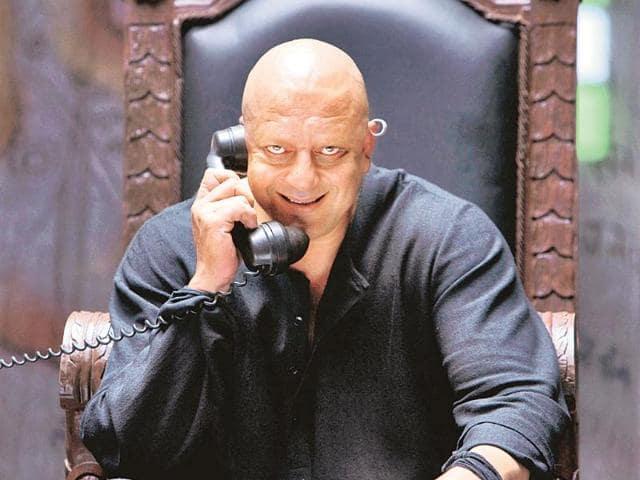 Bald Sanjay Dutt as Kancha Cheena calling in Agneepath movie funny photo and meme