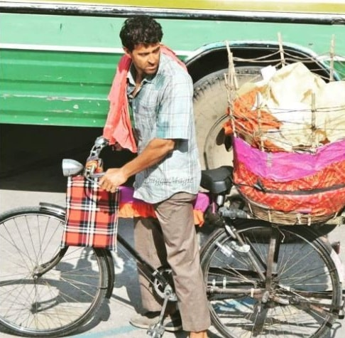 hrithik roshan as Anand Kumar selling paapad on a bicycle in super 30 photos