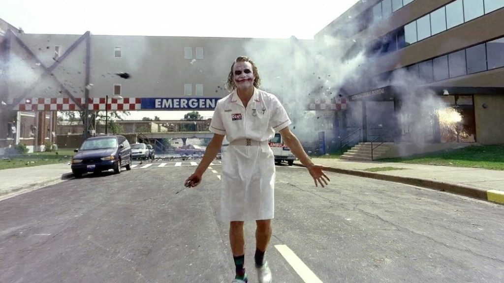 joker coming out in a nurse dress in the dark knight movie after bombing hospital