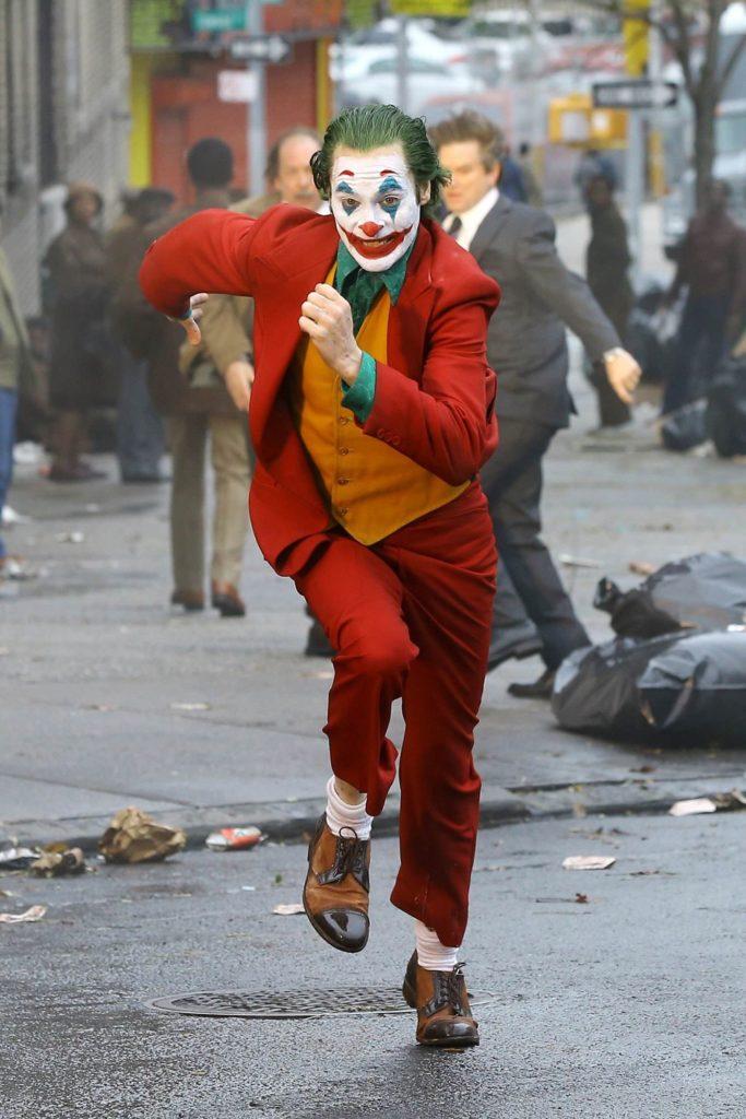 Joaquin Phoenix as the Joker in the Movie running meme template
