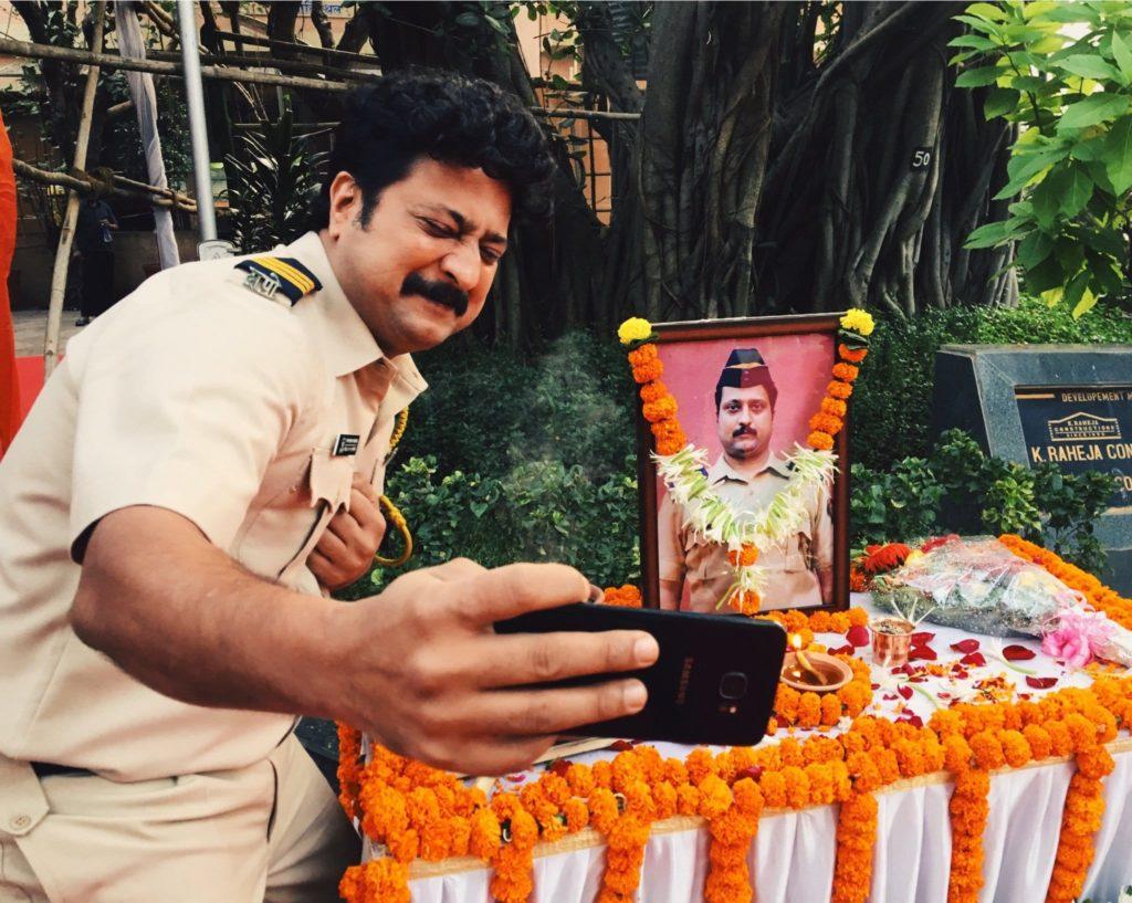 Jitendra Joshi Police Constable Katekar taking selfie with his own photo in Sacred Games Season 2