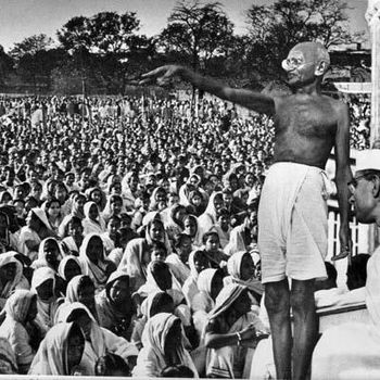 mahatma gandhi giving speech and pointing his hand towards the crowd