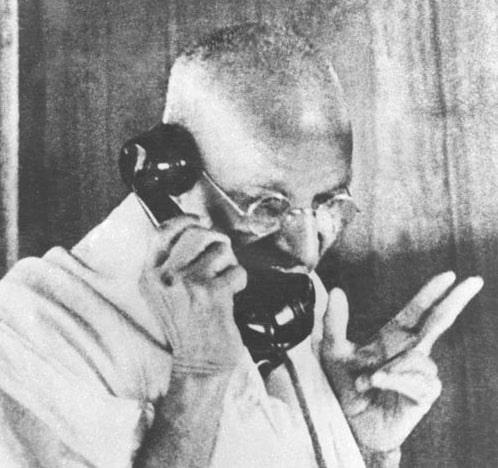 mahatma gandhi talking on phone