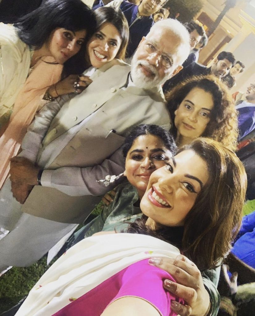 Narendra Modi surrounded by Bollywood Actresses