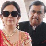 annoyed Mukesh Ambani standing behind Nita Ambani funny face isha ambani wedding meme