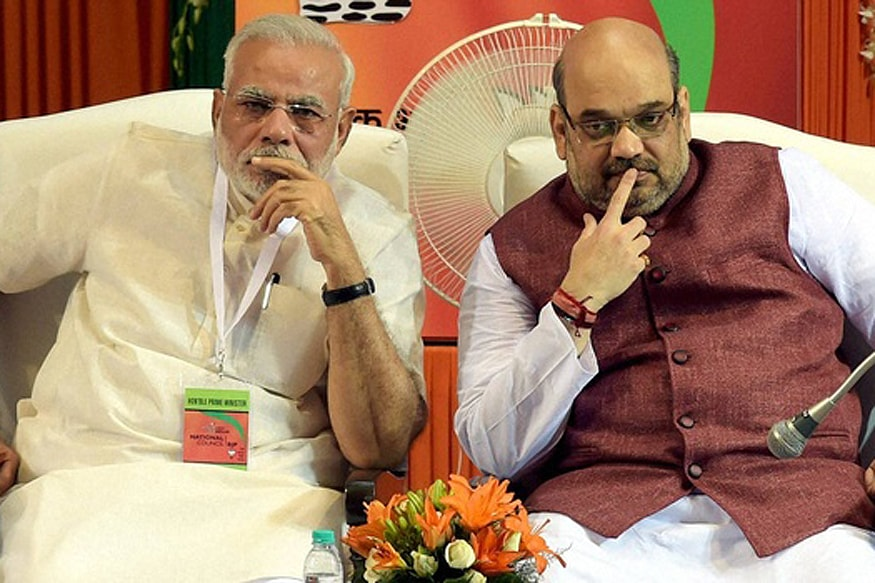 narendra modi and amit shah both thinking photo in a election rally