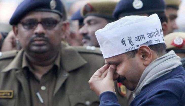 sad arvind kejriwal crying wearing aam aadmi party cap