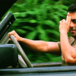 Salman Khan driving a car and showing a bye gesture in tiger zinda hai