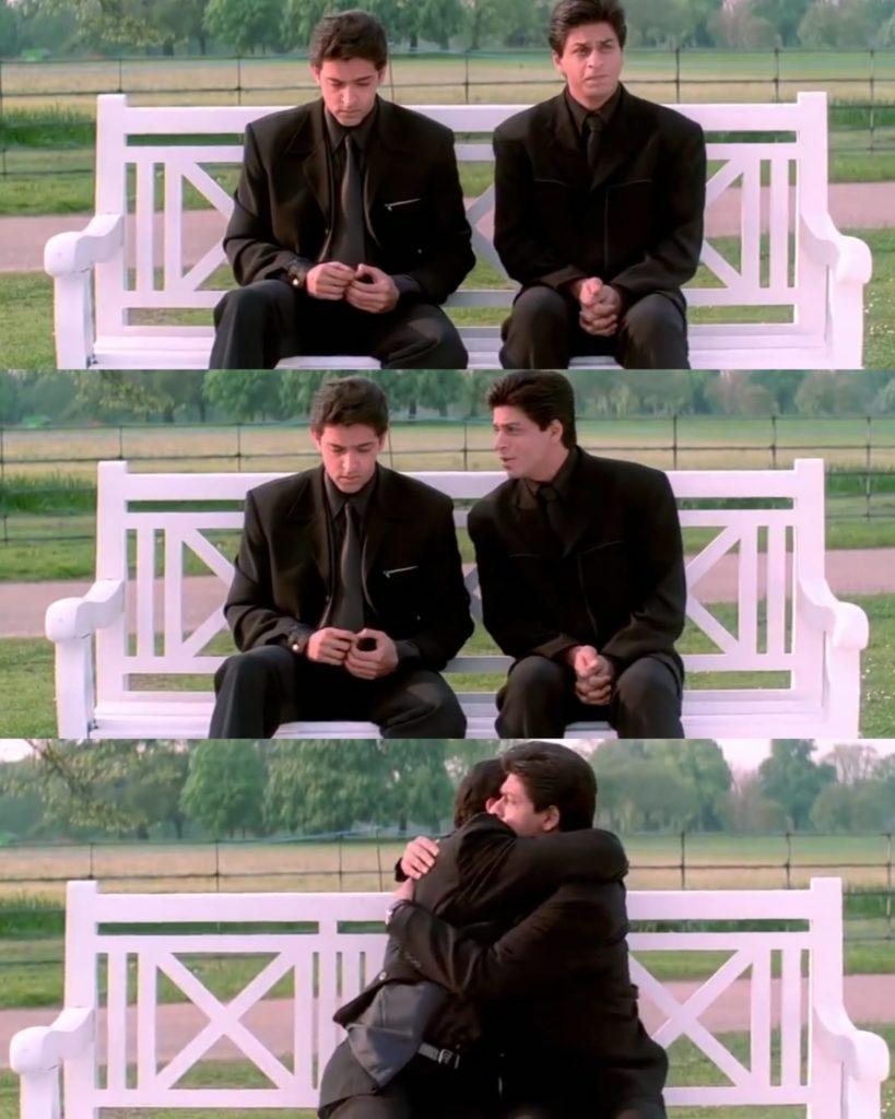 Kabhi Khushi Kabhie Gham Shahrukh Khan as Rahul Hugging Hirthik Roshan as Rohan hugging sitting on a bench scene