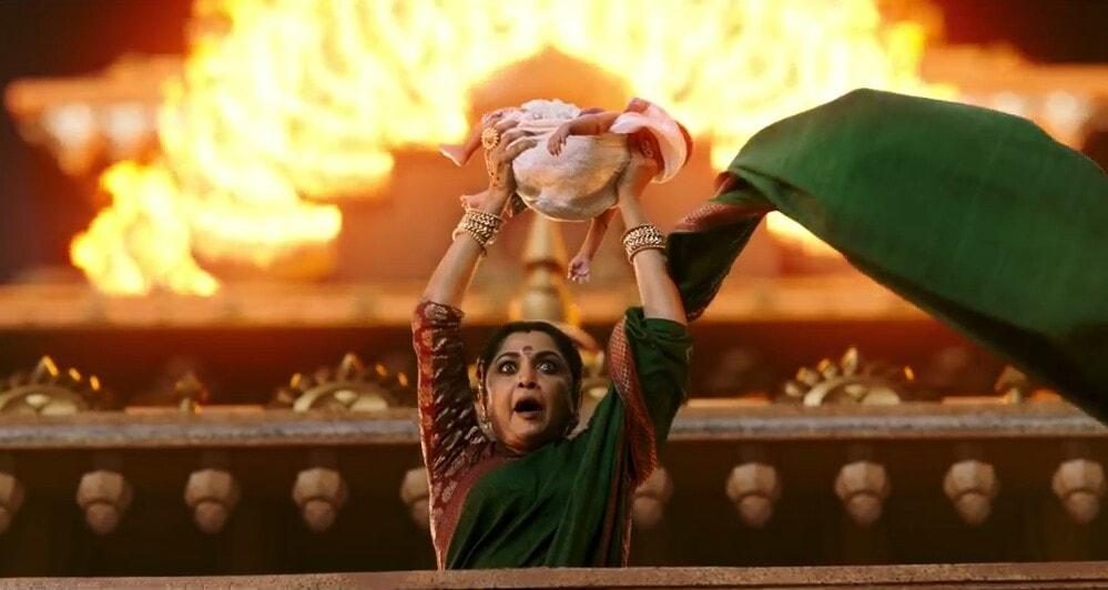 Ramya Krishnan as Sivagami lifting and shouting Amarendra Baahubali