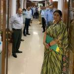 Smriti Irani standing with officers at the office door