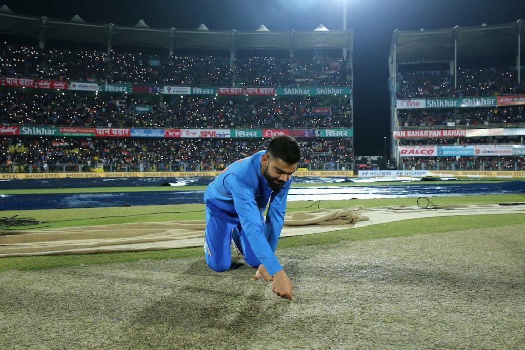 Virat Kohli inspecting the pitch in guwahati meme