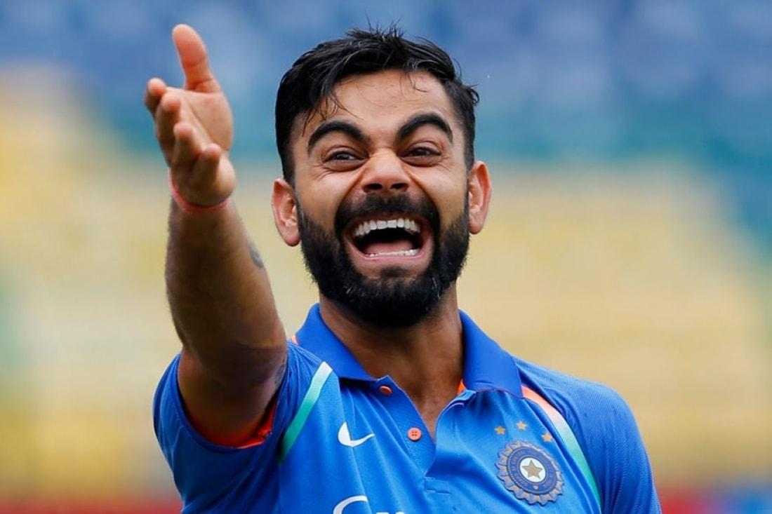 virat kohli laughing pointing at his teammate funny